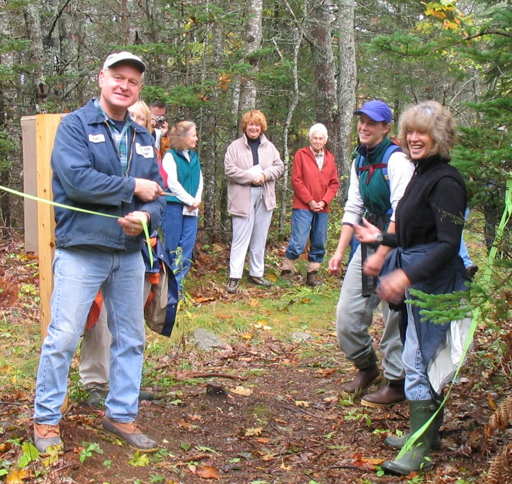 Peter Clapp cuts ribbon to open trail